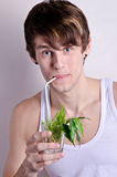 Portrait sexy man with exotic drinks Stock Photography