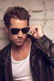 Portrait of sexy man in sun glasses. Stock Photo