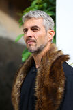 Portrait of a sexy man in wolf  fur, Looking out into the distan Royalty Free Stock Photos