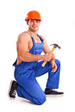 Portrait of sexy mechanic with a hammer Stock Images