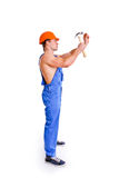 Portrait of sexy mechanic with a hammer Royalty Free Stock Images