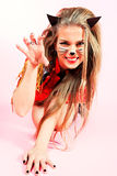 Pussycat. Portrait of a playgirl in pussycat costume alluring over pink background royalty free stock images