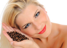 Portrait of sexy pretty woman with coffee beans Stock Images