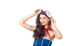Portrait of a sexy sailor woman. Holding her beret. High resolution image taken in studio, isolated on white with copy space for your ad Stock Photography