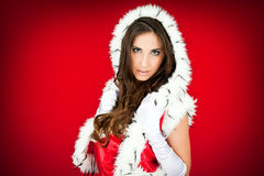 Portrait of a  sexy santa woman on red Stock Image