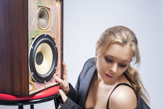 Portrait of Sexy and Seductive Young Caucasian Woman Listening t Royalty Free Stock Images