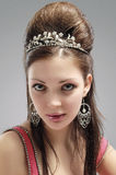 Portrait of Sexy and Sensual Caucasian Young Female with Crown. Royalty Free Stock Photo