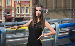 Portrait of sexy slim brunette girl against highway at rush hour Royalty Free Stock Photography