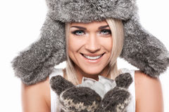 Portrait of smiling blond woman in winter hat. royalty free stock photo