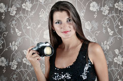 Portrait of Sexy smiling young woman with camera Royalty Free Stock Images