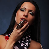 Portrait of sexy topless girl with weapon and american flag Royalty Free Stock Photos