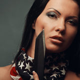 Portrait of sexy topless girl with weapon and american flag Stock Image