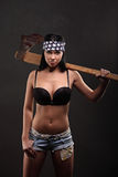 Portrait of sexy topless girl with weapon and american flag Royalty Free Stock Images