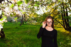 Portrait of a sexy woman in the apple orchard Royalty Free Stock Images