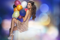 Portrait of the sexy woman with balloons Stock Photography
