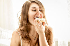 Portrait of sexy woman biting big donut Royalty Free Stock Photography