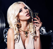 Portrait of sexy woman with blond hair with glass of champagne Stock Photography