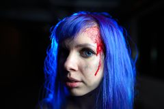 Portrait of sexy woman with blue hair looking as killer victim Stock Photos