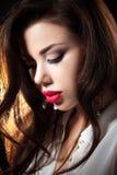 Portrait Of Sexy Woman On a dark metallic Background Stock Image