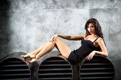 Portrait Of Sexy Woman On a dark metallic Background Royalty Free Stock Photos