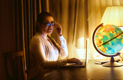 Portrait of sexy woman in eyeglasses using laptop Royalty Free Stock Image