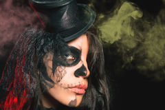 Portrait of sexy woman with gothic makeup smokey eyes. Vampire, evil. Goth. Horror. Secret. Fashion. Venetian carnival. Hot babe. Halloween party Stock Photos