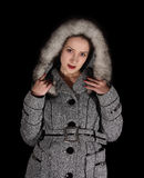 Portrait of sexy woman in gray coat Stock Photos