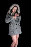 Portrait of sexy woman in gray coat Stock Images
