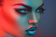 Portrait of sexy woman with healthy skin in red and blue lights Royalty Free Stock Photos