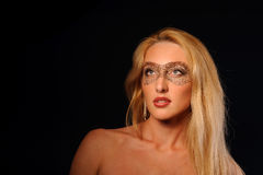 Portrait of woman in make-up party mask Stock Image