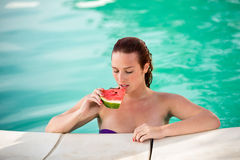Portrait of sexy woman with piece of watermelon on pool Royalty Free Stock Photo
