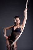 Portrait of sexy woman posing with rope Stock Photos