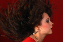 Portrait about sexy woman in red with flying hair Royalty Free Stock Photos
