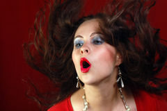 Portrait about sexy woman in red with flying hair Stock Photo