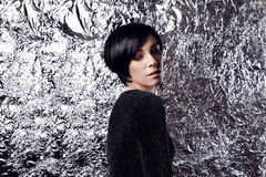 Portrait of sexy woman with short black hair, party look. Glitter and silver background Royalty Free Stock Photography
