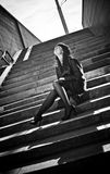 Portrait of sexy woman sitting on stairs on street Royalty Free Stock Photos