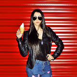 Portrait of sexy woman in sunglasses with ice cream near red wal Stock Images