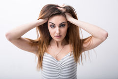 Portrait of a woman touching her hair royalty free stock photos