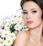 Portrait of sexy woman with white flowers Royalty Free Stock Photography