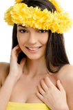 Portrait of a sexy woman with wreath of yellow flowers. Royalty Free Stock Image