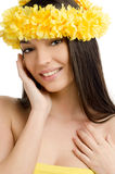 Portrait of a sexy woman with wreath of yellow flowers. Stock Photo