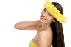 Portrait of a sexy woman with wreath of yellow flowers. Royalty Free Stock Photography
