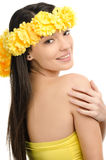 Portrait of a sexy woman with wreath of yellow flowers. Stock Images