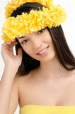 Portrait of a sexy woman with wreath of yellow flowers. Royalty Free Stock Photo