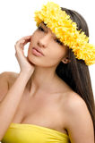Portrait of a sexy woman with wreath of yellow flowers on the head. Stock Photo