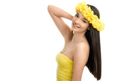 Portrait of a woman with wreath of yellow flowers on the head. Girl with long straight hair. Girl with long straight hair. stock photo