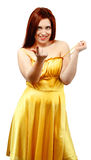 Portrait of a woman in yellow dress making a beckoning gest. Ure on a white isolated background royalty free stock photo