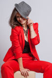 Portrait of a sexy young lady in a red suit Royalty Free Stock Photography