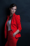 Portrait of a sexy young lady in a red suit Stock Photo
