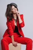Portrait of a sexy young lady in a red suit Stock Photos